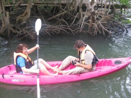 Kayaking through the mangroves - Bronwen paddling and Fred filming